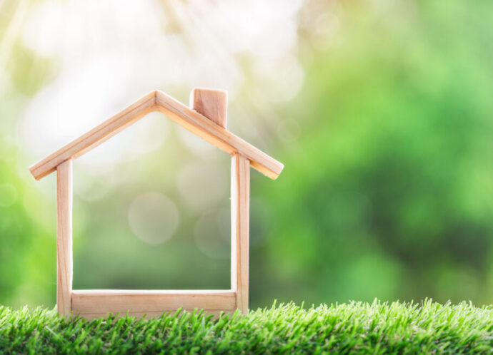 Wooden,Model,House,Place,On,The,Grass.,Concept,Of,Real